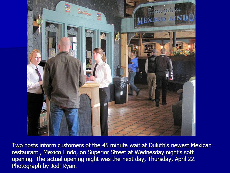 Two hosts inform customers of the 45 minute wait at Duluth s newest Mexican restaurant, Mexico Lindo, on Superior Street at Wednesday night s soft opening.
