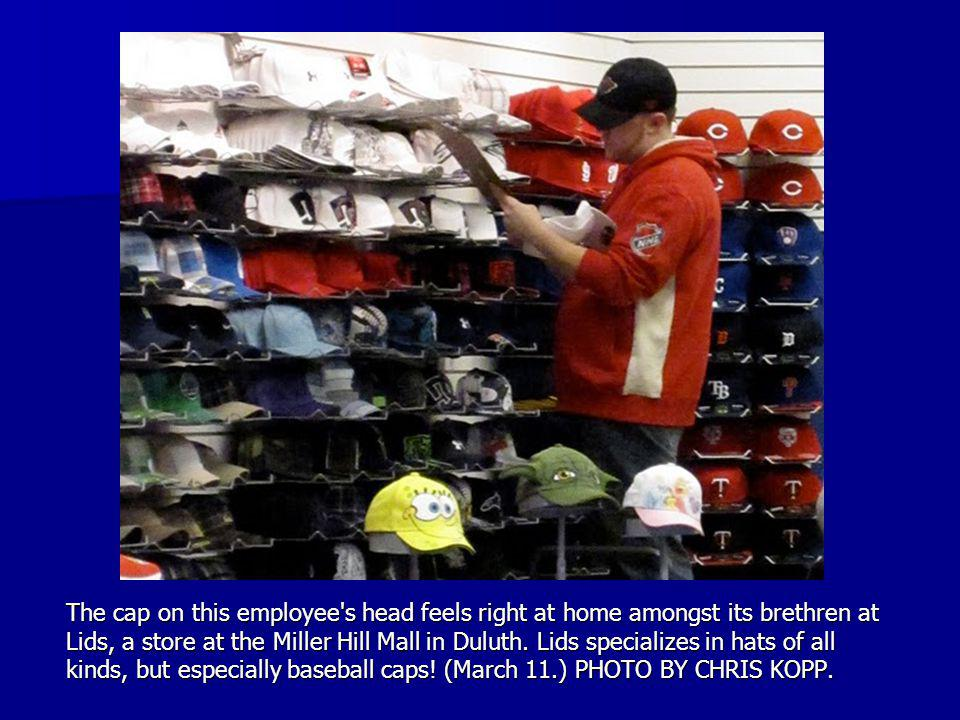 The cap on this employee s head feels right at home amongst its brethren at Lids, a store at the Miller Hill Mall in Duluth.