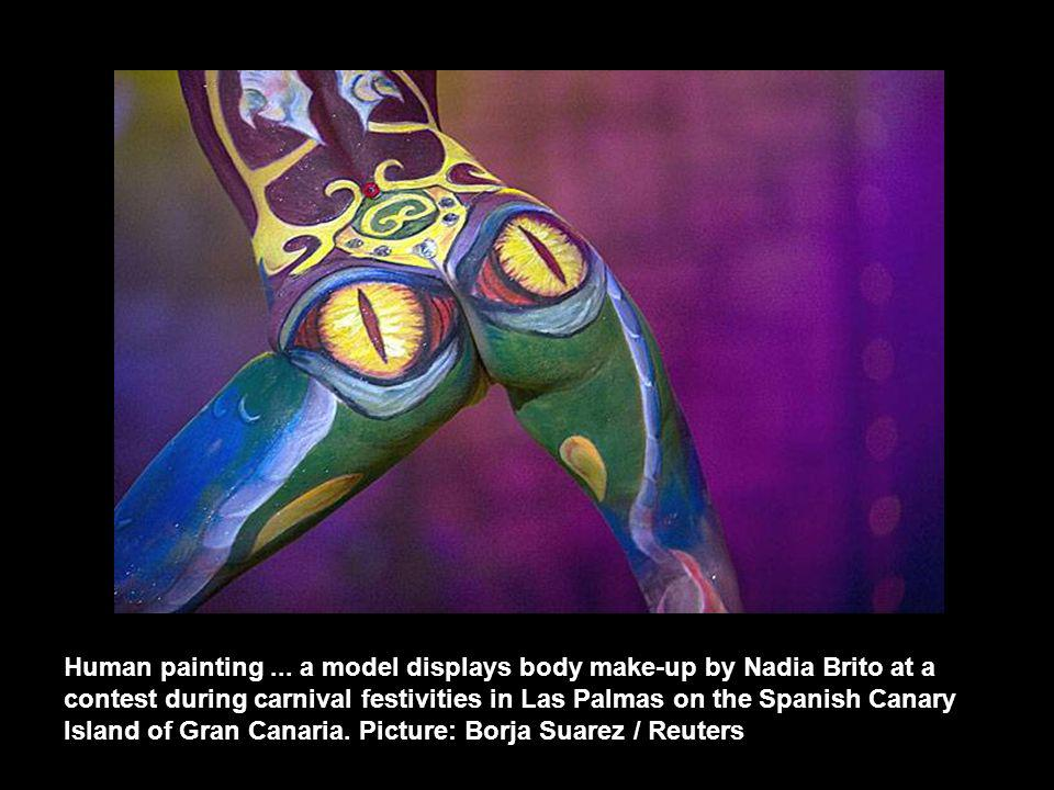 Human painting... a model displays body make-up by Nadia Brito at a contest during carnival festivities in Las Palmas on the Spanish Canary Island of