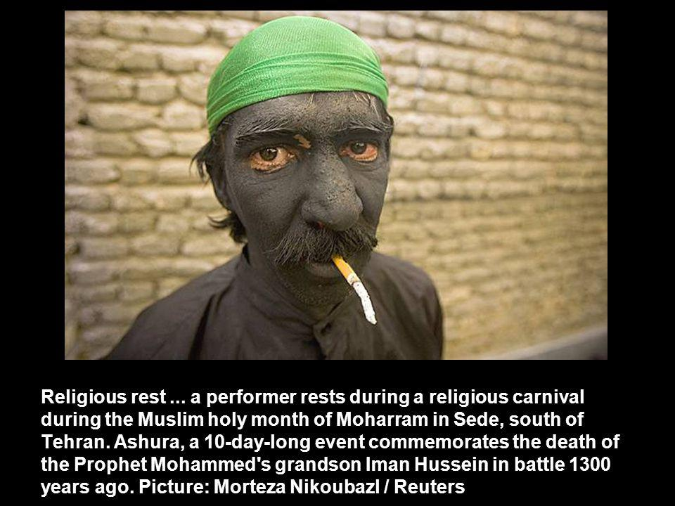 Religious rest... a performer rests during a religious carnival during the Muslim holy month of Moharram in Sede, south of Tehran. Ashura, a 10-day-lo