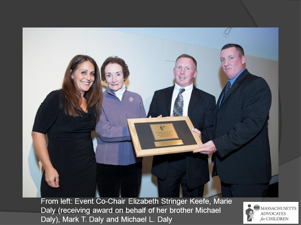 From left: Event Co-Chair Elizabeth Stringer Keefe, Marie Daly (receiving award on behalf of her brother Michael Daly), Mark T. Daly and Michael L. Da