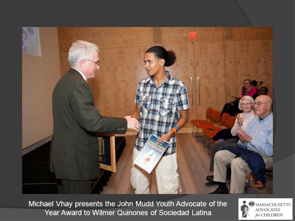 Michael Vhay presents the John Mudd Youth Advocate of the Year Award to Wilmer Quinones of Sociedad Latina