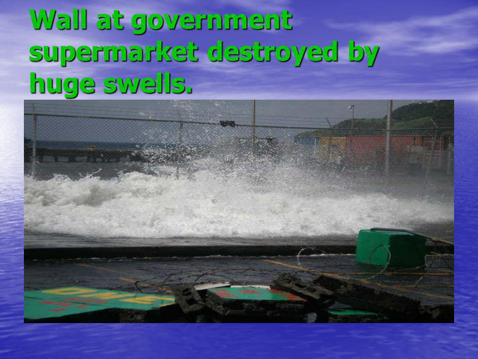Wall at government supermarket destroyed by huge swells.