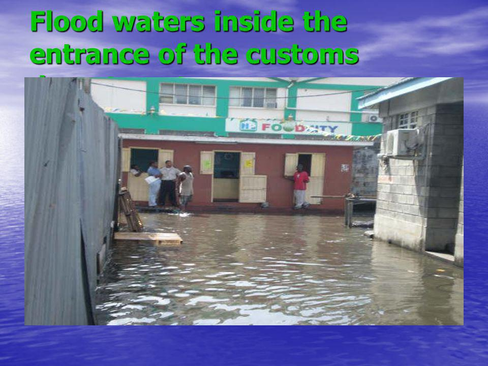 Flood waters inside the entrance of the customs department.