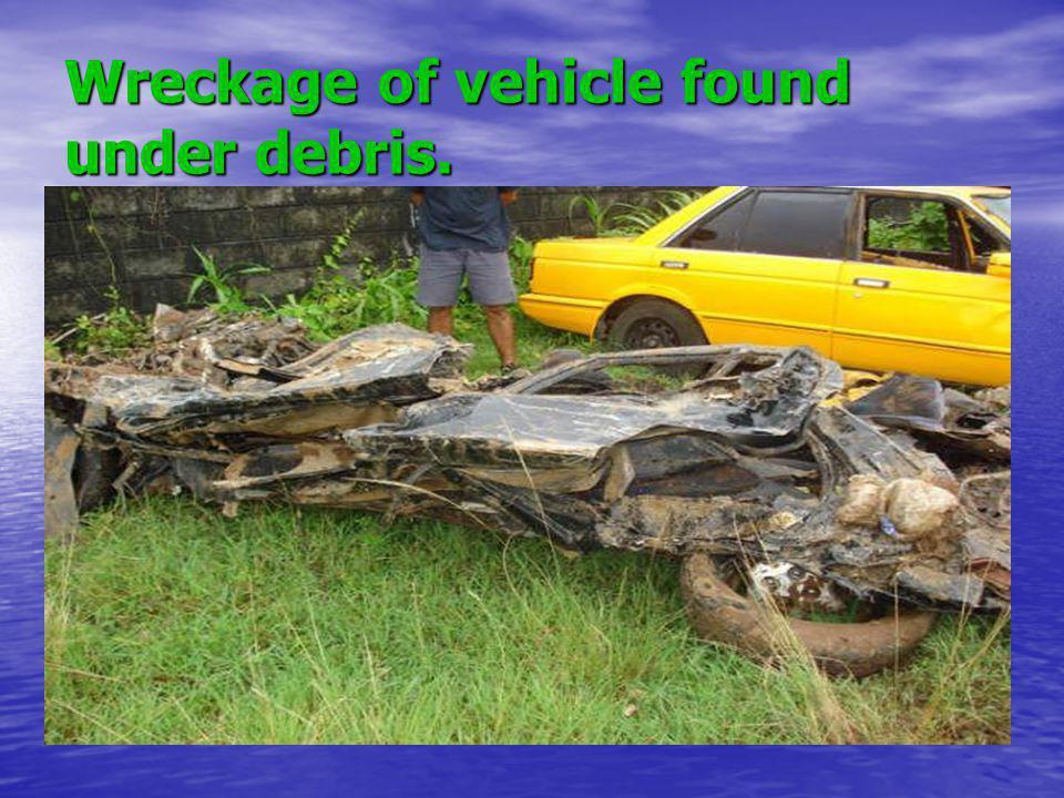 Wreckage of vehicle found under debris.