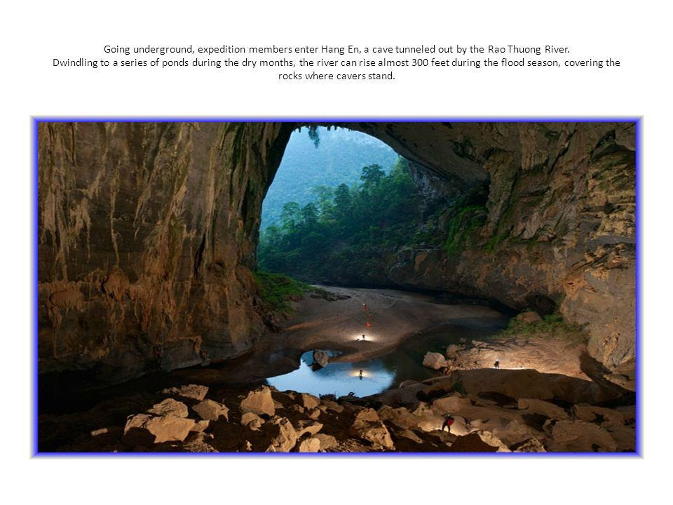 Going underground, expedition members enter Hang En, a cave tunneled out by the Rao Thuong River.
