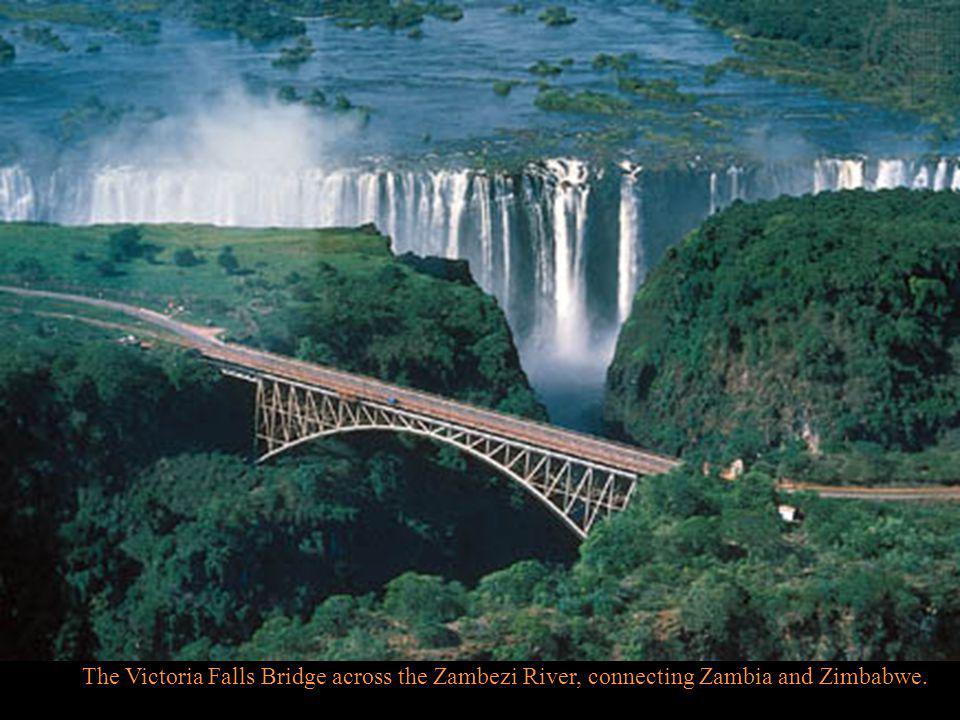 The churning waters -- two kilometers (1 1/4 miles) wide at the point of the falls -- rumble and roar and tumble through a narrow exit into the Batoka Gorge on its way to the Mozambique Channel of Eastern Africa.
