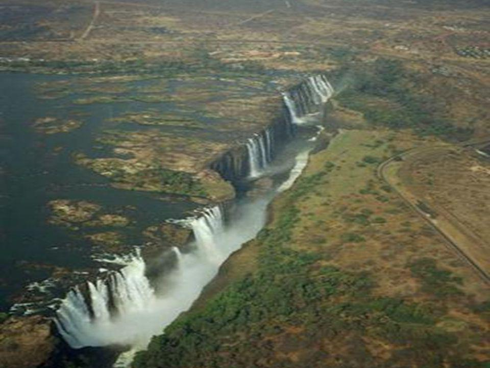 The Zambezi River s gentle roll through Africa is interrupted abruptly and spectacularly when the flat basalt basin that forms the river s bed suddenly gives way.