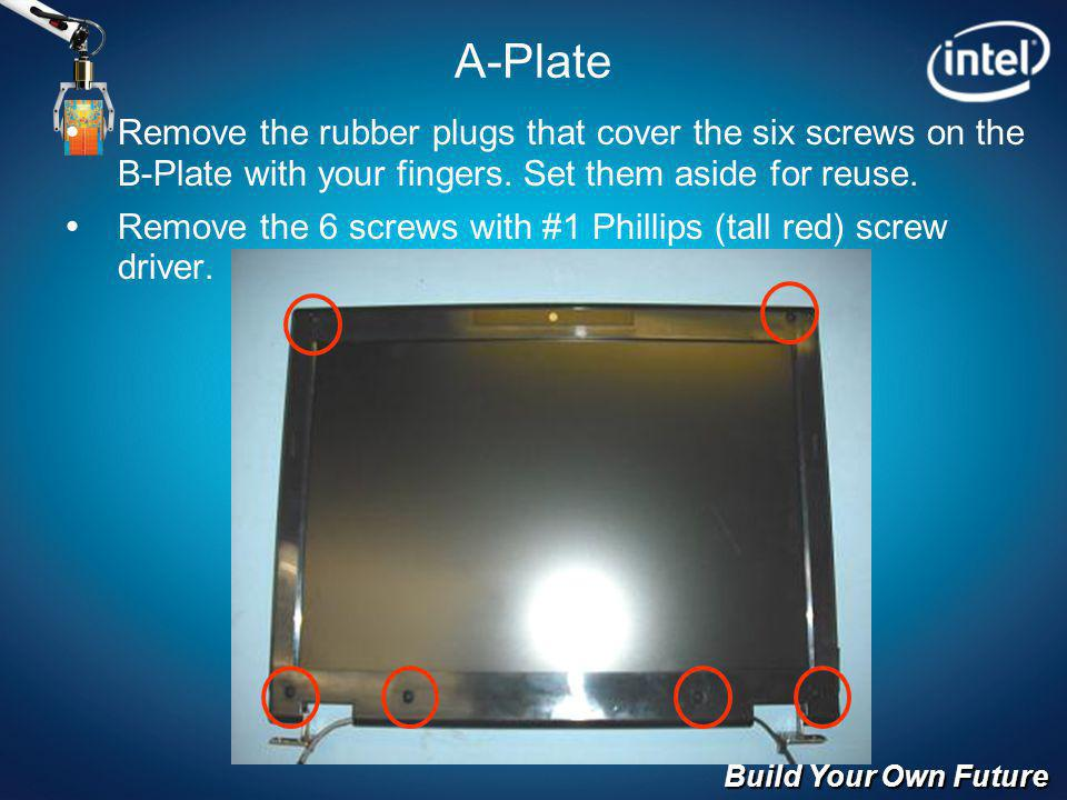 Build Your Own Future A-Plate Remove the rubber plugs that cover the six screws on the B-Plate with your fingers.