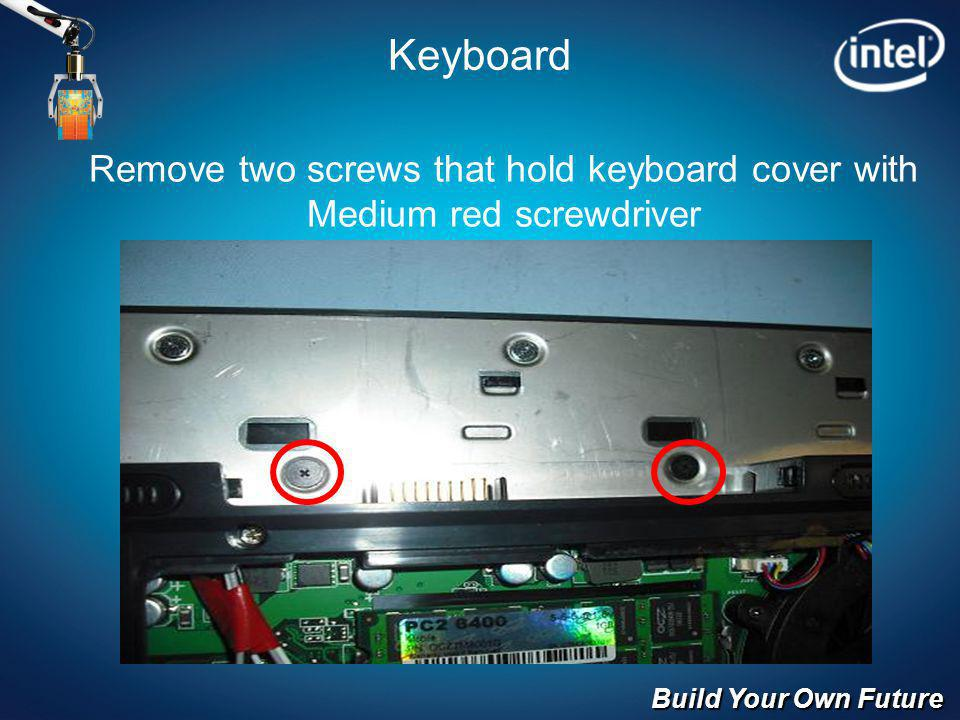 Build Your Own Future Keyboard Remove two screws that hold keyboard cover with Medium red screwdriver