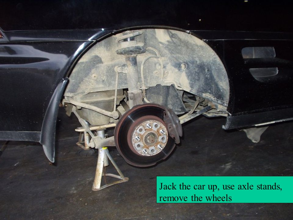 Jack the car up, use axle stands, remove the wheels