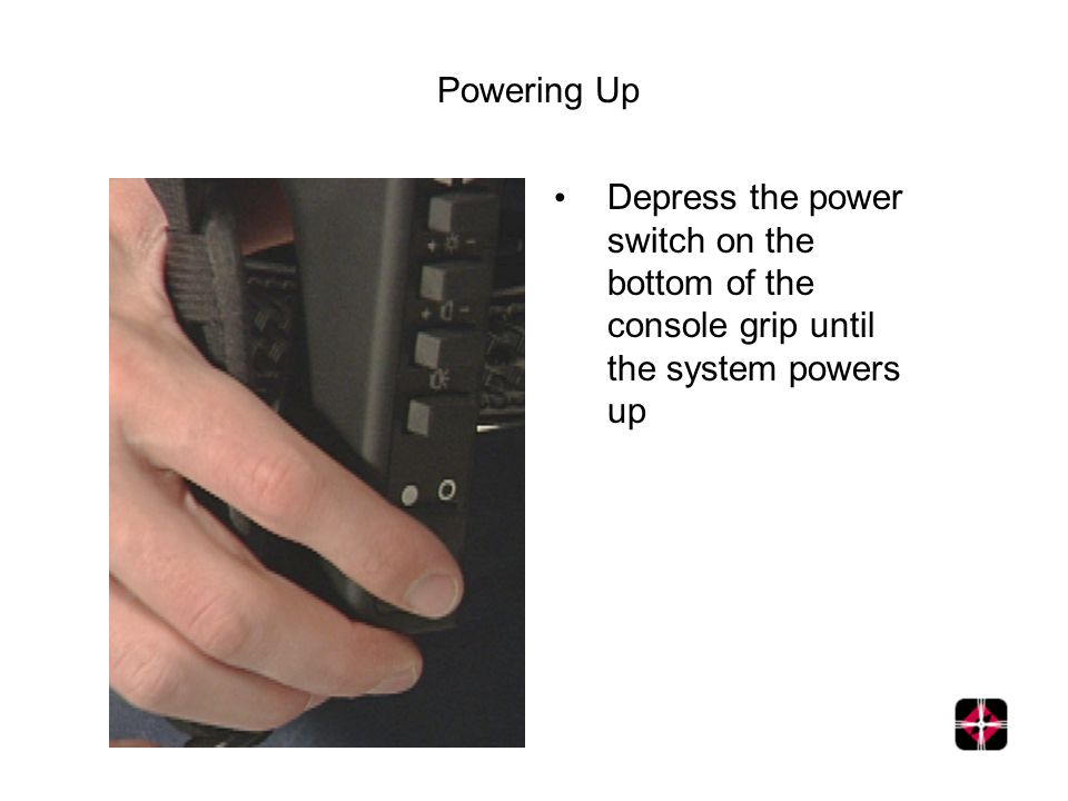 Powering Up Depress the power switch on the bottom of the console grip until the system powers up
