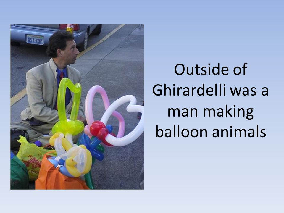 Outside of Ghirardelli was a man making balloon animals