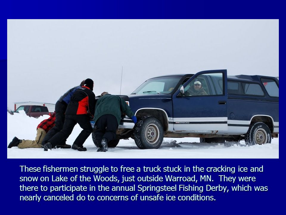 These fishermen struggle to free a truck stuck in the cracking ice and snow on Lake of the Woods, just outside Warroad, MN. They were there to partici