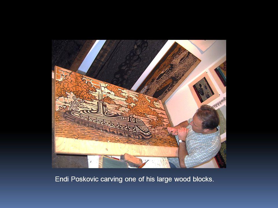 Endi Poskovic carving one of his large wood blocks.