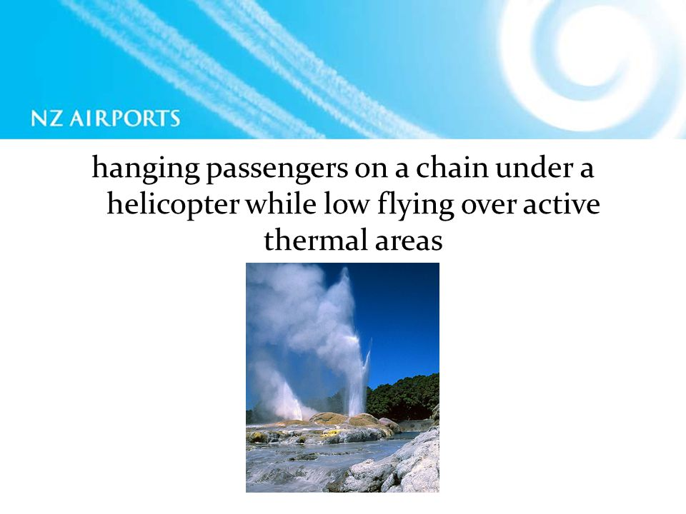 hanging passengers on a chain under a helicopter while low flying over active thermal areas