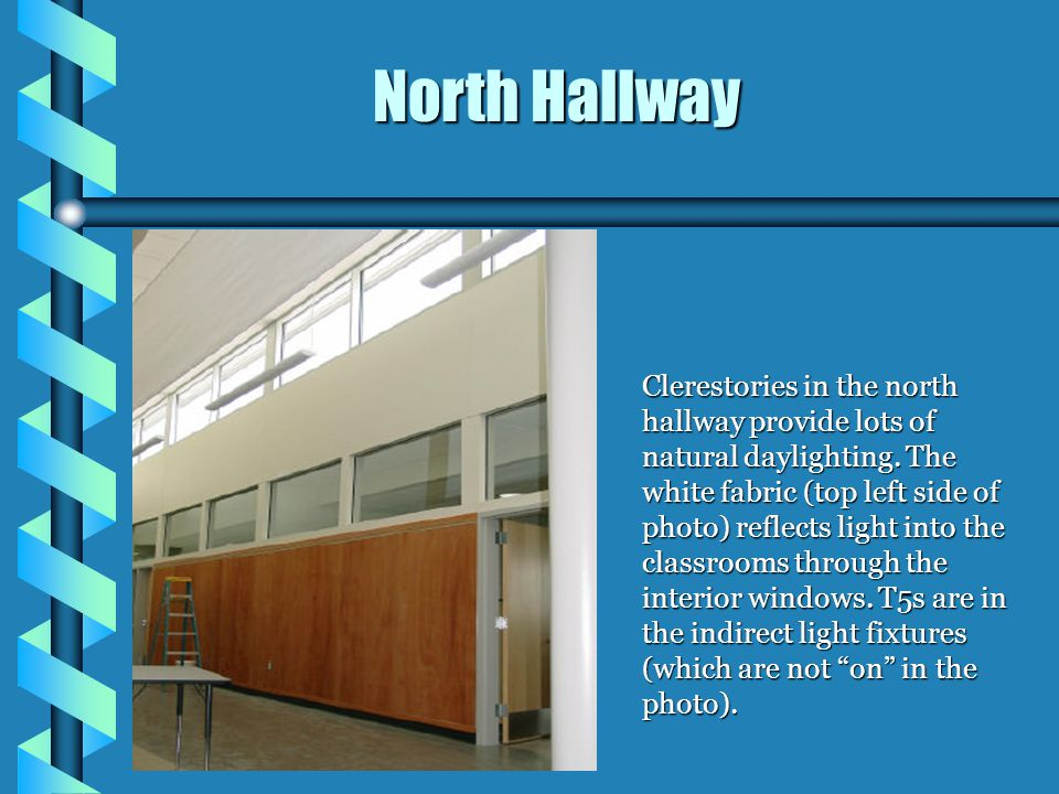 Clerestories in the north hallway provide lots of natural daylighting. The white fabric (top left side of photo) reflects light into the classrooms th