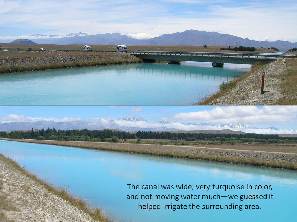 The canal was wide, very turquoise in color, and not moving water muchwe guessed it helped irrigate the surrounding area.