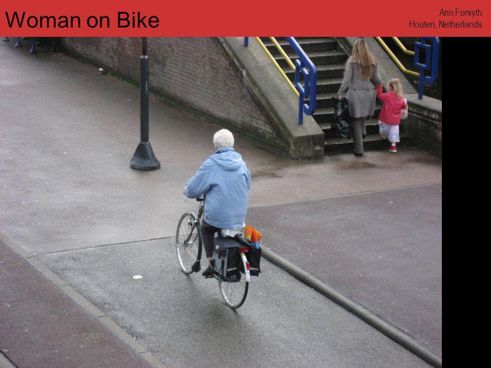 www.annforsyth.net Woman Carrying Bike Ann Forsyth Houten, Netherlands