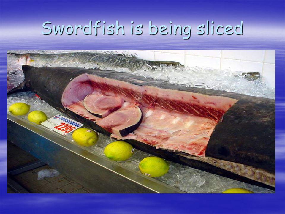 Swordfish is being sliced