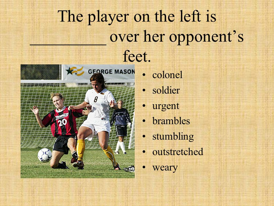 The player on the left is _________ over her opponents feet. colonel soldier urgent brambles stumbling outstretched weary