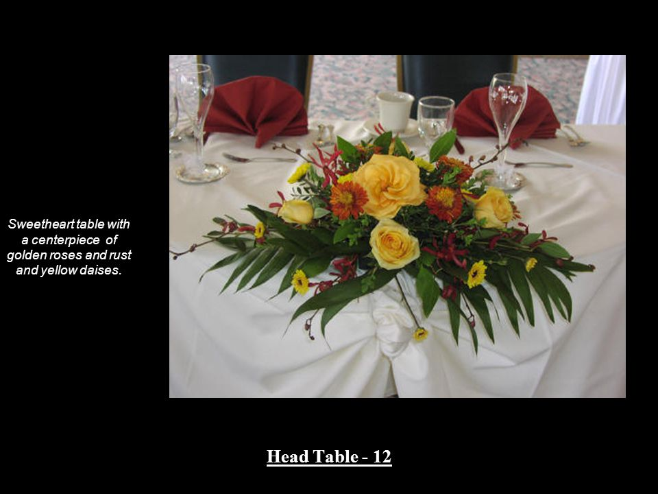Head Table - 12 Sweetheart table with a centerpiece of golden roses and rust and yellow daises.