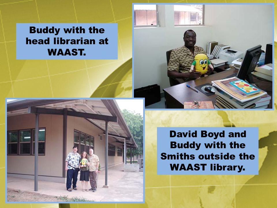 Buddy with the head librarian at WAAST. David Boyd and Buddy with the Smiths outside the WAAST library.