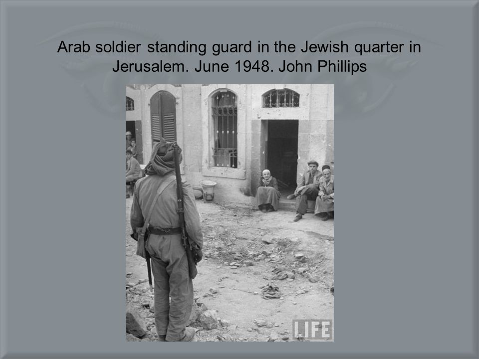 Arab soldier standing guard in the Jewish quarter in Jerusalem. June 1948. John Phillips