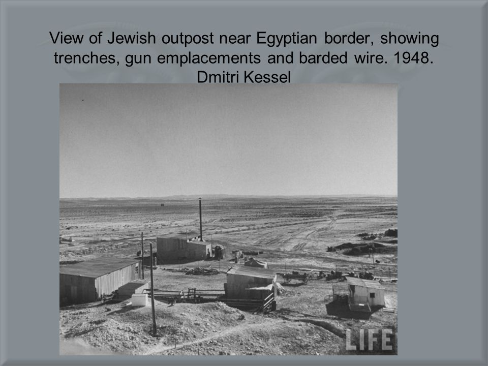 View of Jewish outpost near Egyptian border, showing trenches, gun emplacements and barded wire.