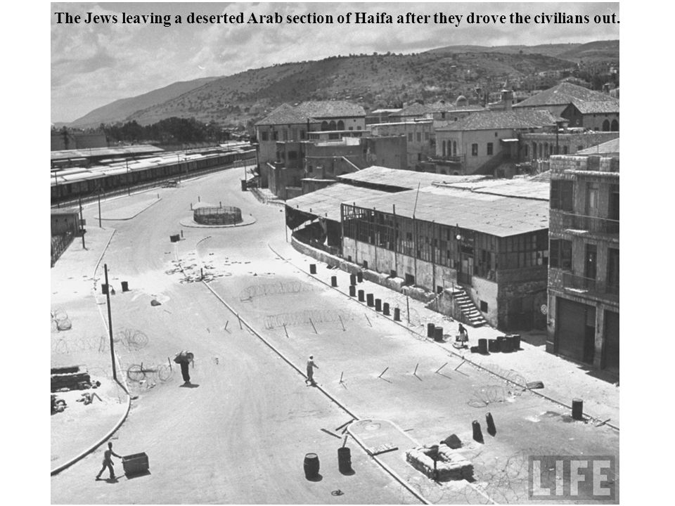 The Jews leaving a deserted Arab section of Haifa after they drove the civilians out.
