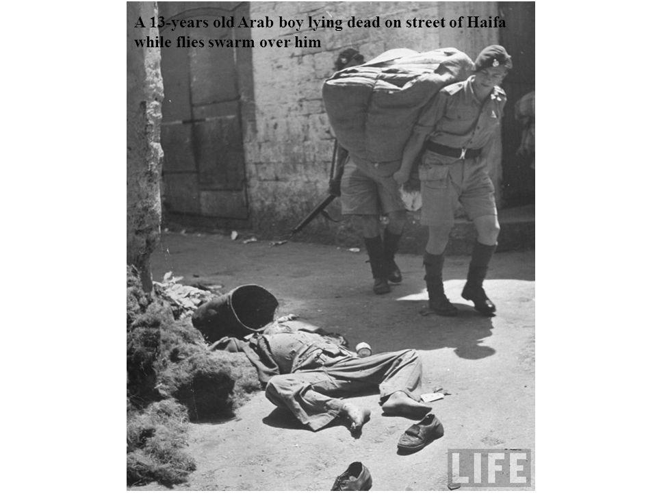 A 13-years old Arab boy lying dead on street of Haifa while flies swarm over him