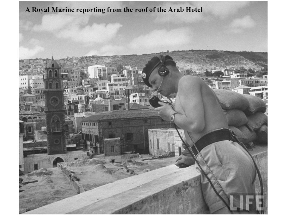 A Royal Marine reporting from the roof of the Arab Hotel