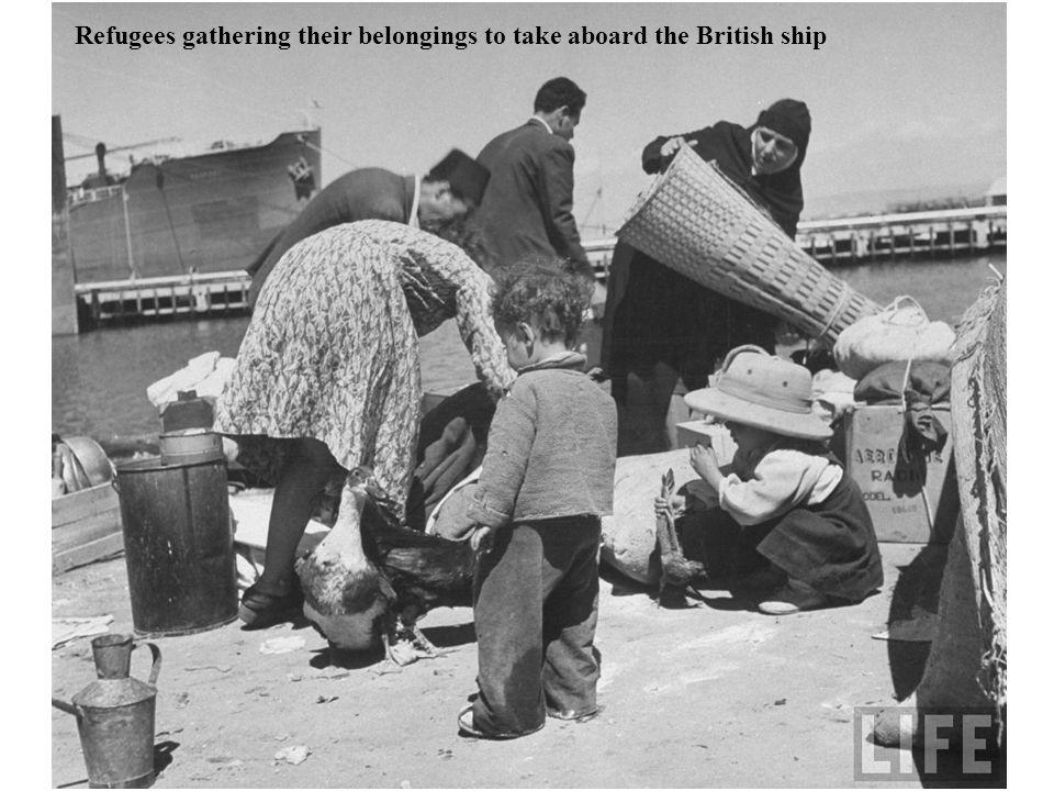 Refugees gathering their belongings to take aboard the British ship