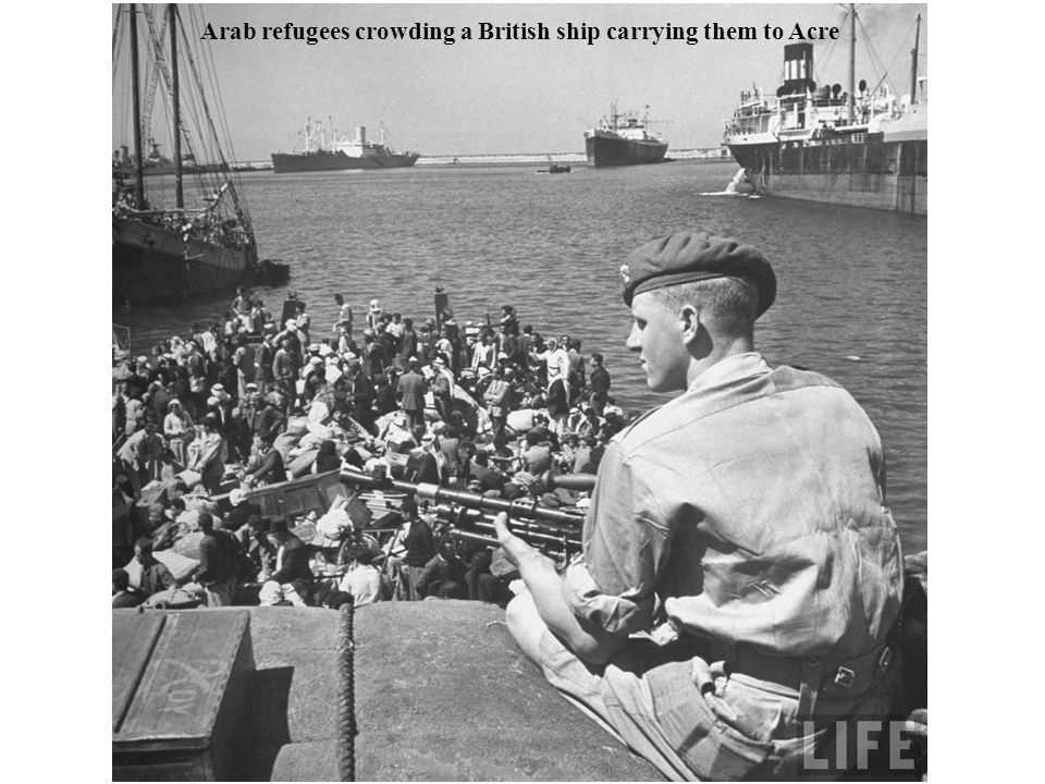 Arab refugees crowding a British ship carrying them to Acre