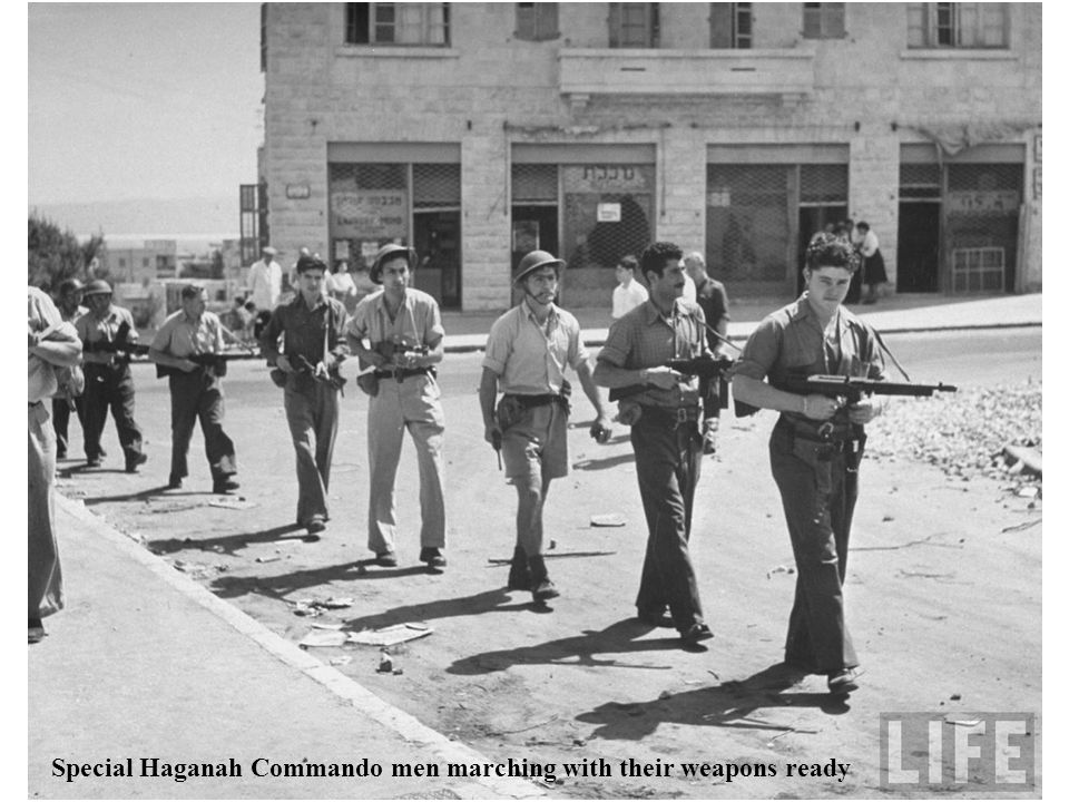 Special Haganah Commando men marching with their weapons ready