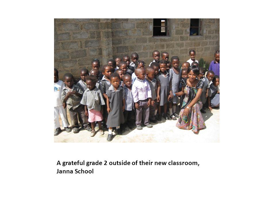 A grateful grade 2 outside of their new classroom, Janna School