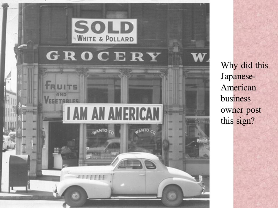 Why did this Japanese- American business owner post this sign?