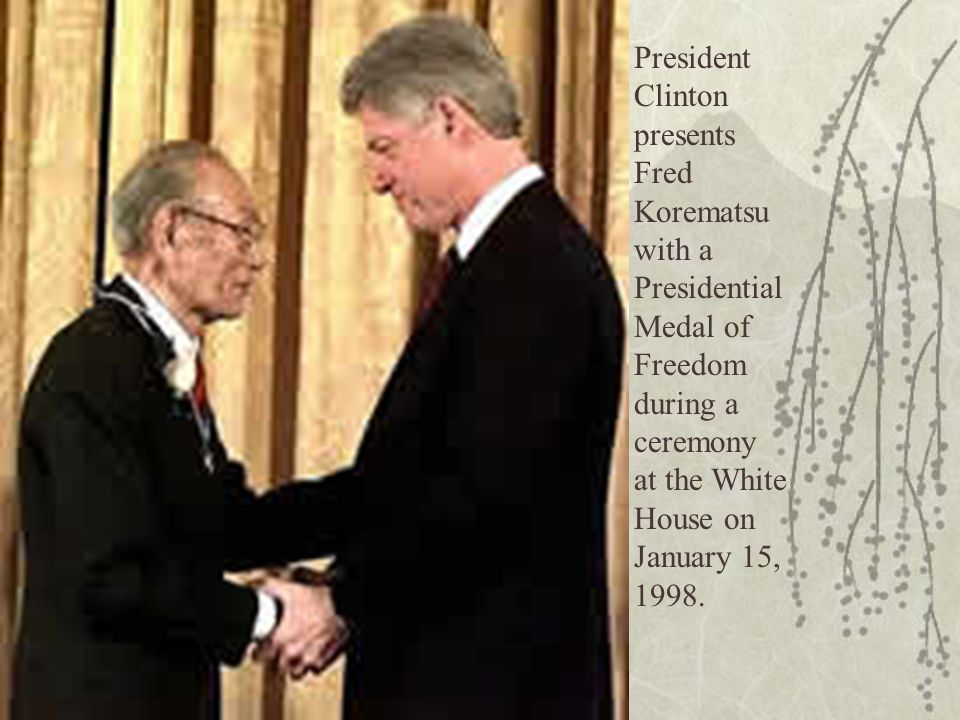 President Clinton presents Fred Korematsu with a Presidential Medal of Freedom during a ceremony at the White House on January 15, 1998.