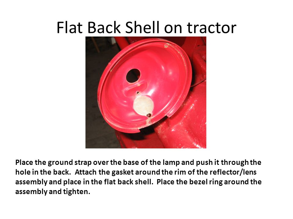 Flat Back Shell on tractor Place the ground strap over the base of the lamp and push it through the hole in the back.