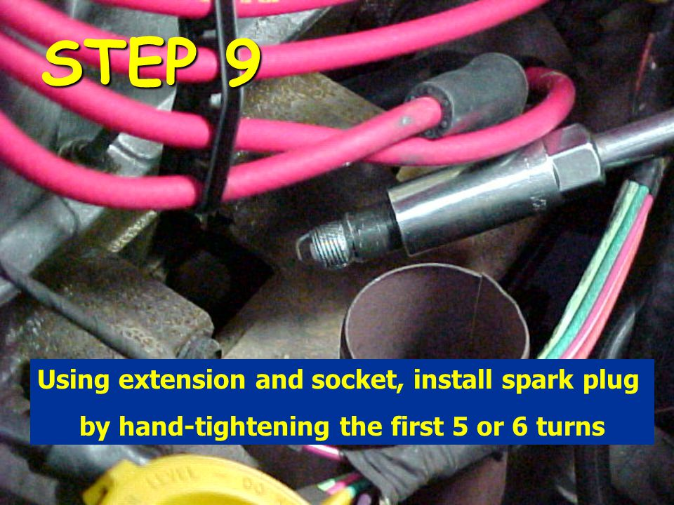 STEP 9 Using extension and socket, install spark plug by hand-tightening the first 5 or 6 turns