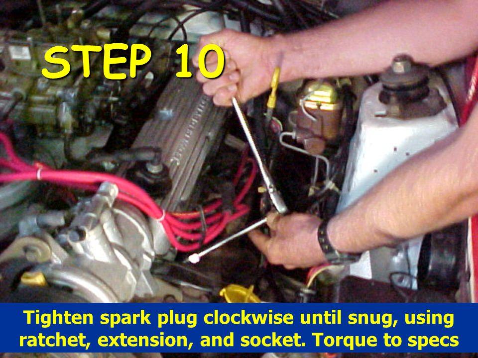 STEP 10 Tighten spark plug clockwise until snug, using ratchet, extension, and socket. Torque to specs
