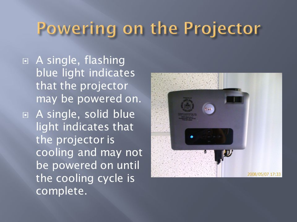 A single, flashing blue light indicates that the projector may be powered on.