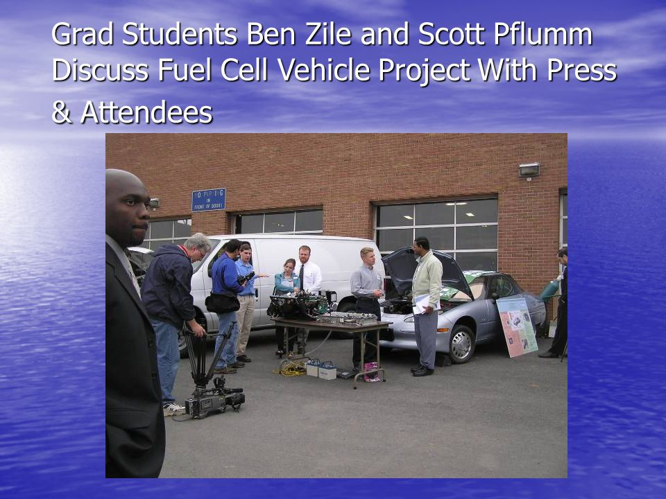 Grad Students Ben Zile and Scott Pflumm Discuss Fuel Cell Vehicle Project With Press & Attendees