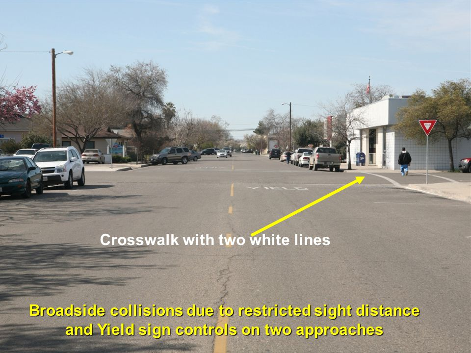 Crosswalk with two white lines Broadside collisions due to restricted sight distance and Yield sign controls on two approaches
