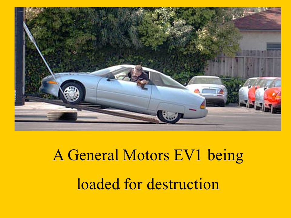 A General Motors EV1 being loaded for destruction