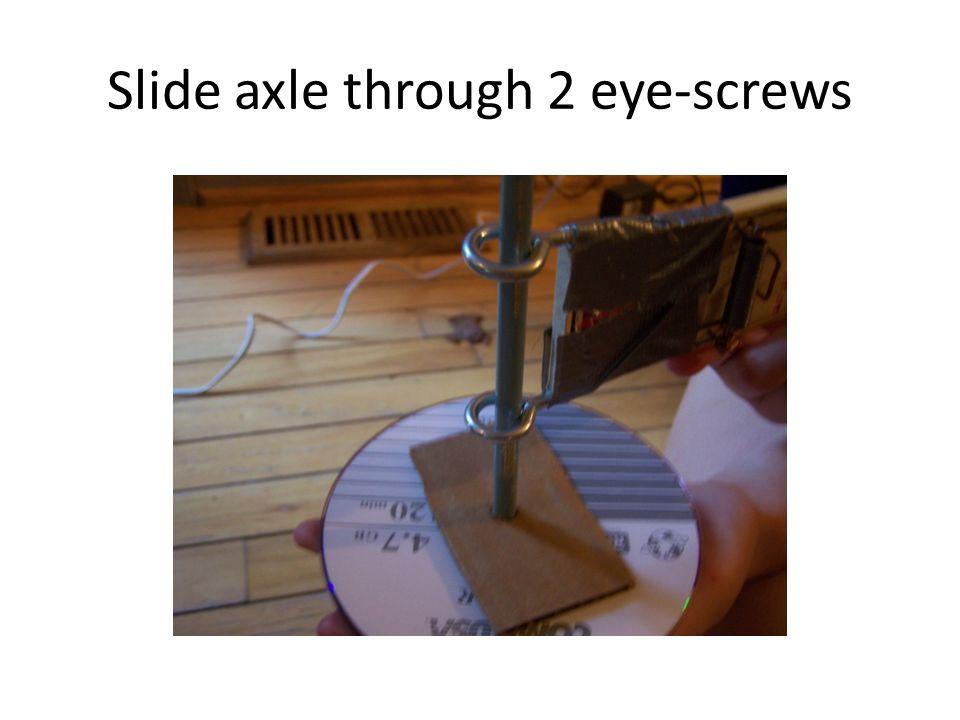 Slide axle through 2 eye-screws