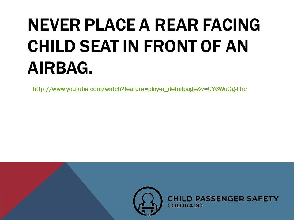 NEVER PLACE A REAR FACING CHILD SEAT IN FRONT OF AN AIRBAG.
