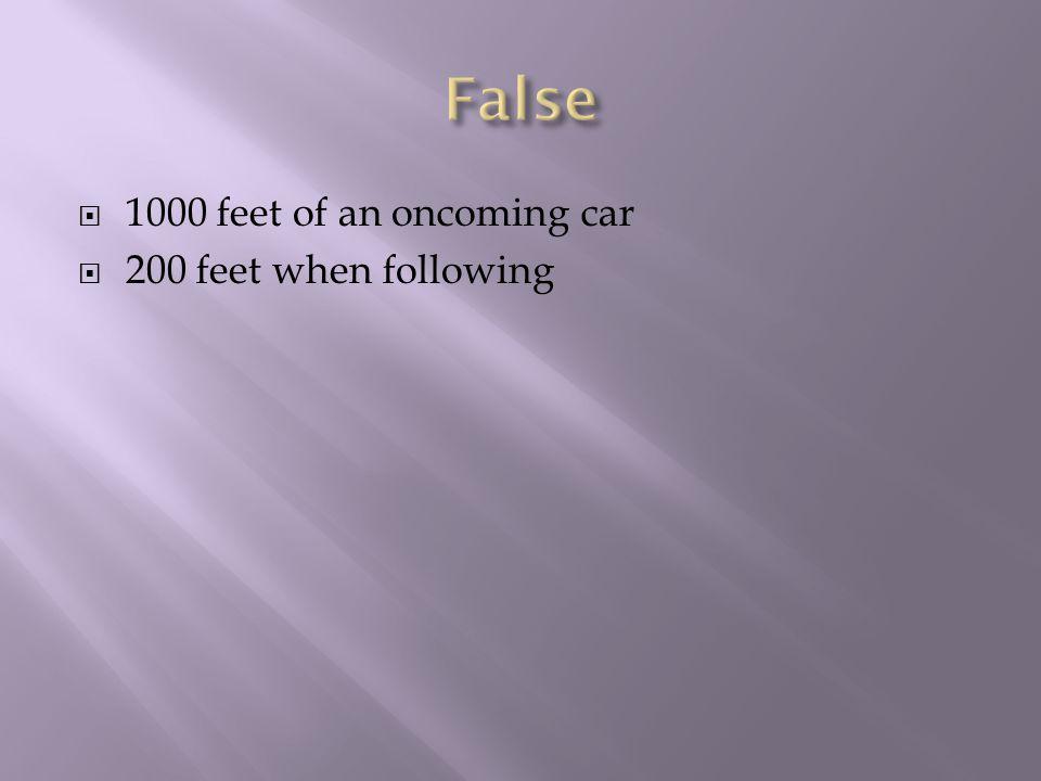 1000 feet of an oncoming car 200 feet when following