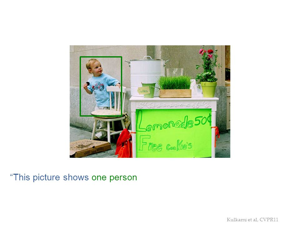 This picture shows one person, one grass, one chair, and one potted plant. The person is near the green grass, and in the chair. The green grass is by