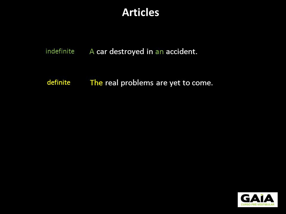 Articles indefinite definite A car destroyed in an accident. The real problems are yet to come.